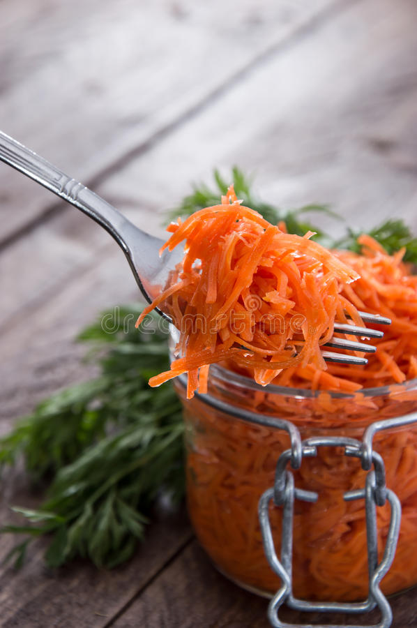 Fork with Carrot Salad. In front of a Glass royalty free stock photography