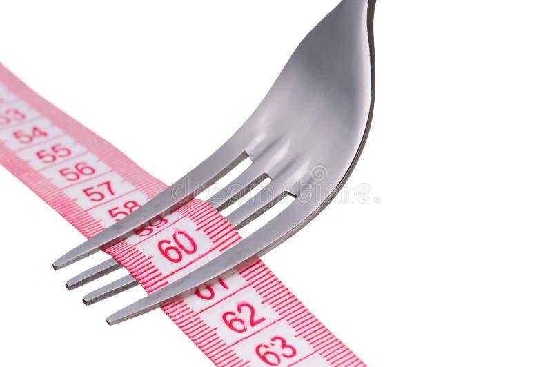 Fork con la cinta de la medida foto de archivo