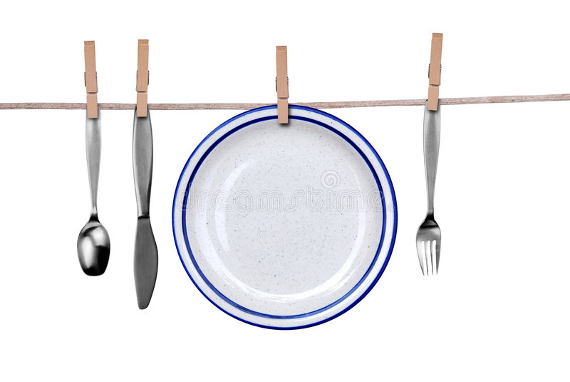 Fork, cuchillo, cuchara y placa o fotografía de archivo