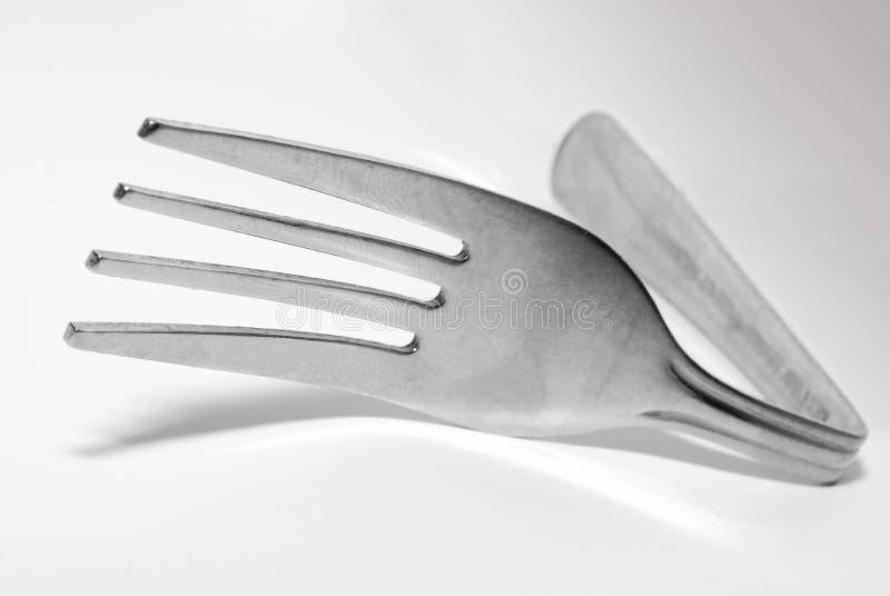 Fork de plata doblada imágenes de archivo libres de regalías