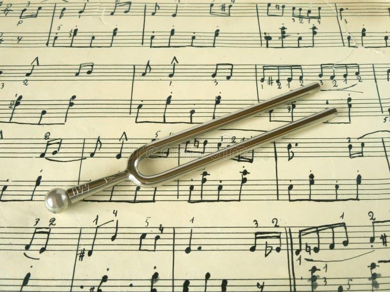 Fork en vieja música de hoja fotografía de archivo libre de regalías