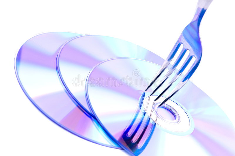 Fork on a heap of Cd's stock photo