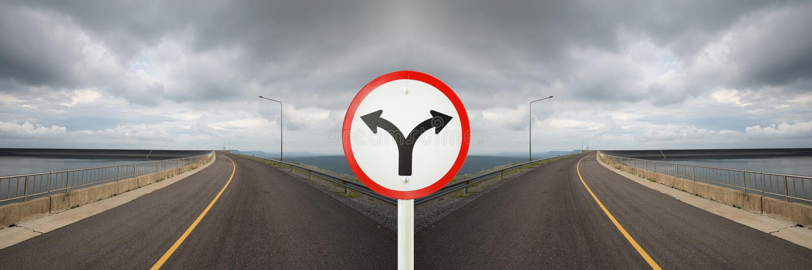Fork junction sign with crossroads spliting in two way stock images