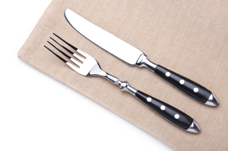 Fork and knife. On a flax napkin stock photography
