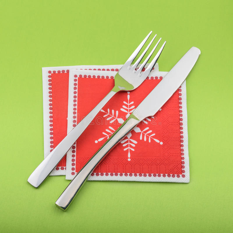 Fork and knife in a christmas napkin.  stock images