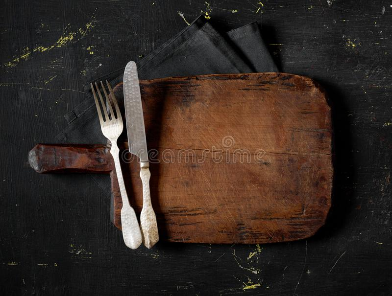 Fork, knife and cutting board stock images