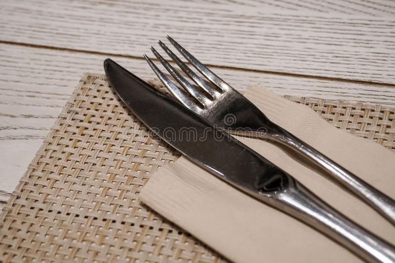 Fork knife dining kitchen ware set on table. Fork and knife dining kitchen ware set on table royalty free stock photos