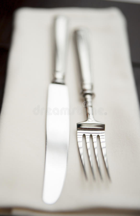 Fork, knife and napkin. Very shallow focus stock image