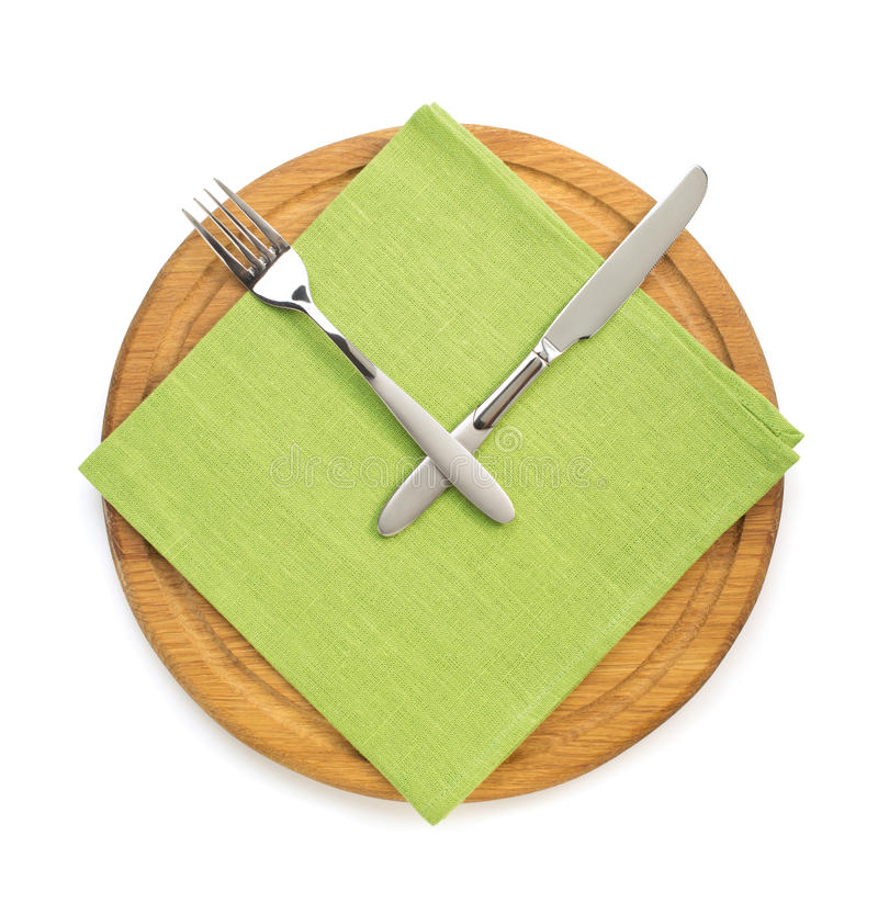 Fork with knife at napkin cloth on white. Background royalty free stock photos