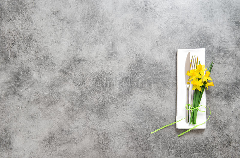 Fork knife napkin on table plate spring flowers stock image