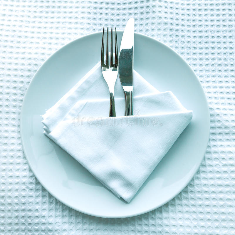 Fork And Knife On Plate Stock Photos