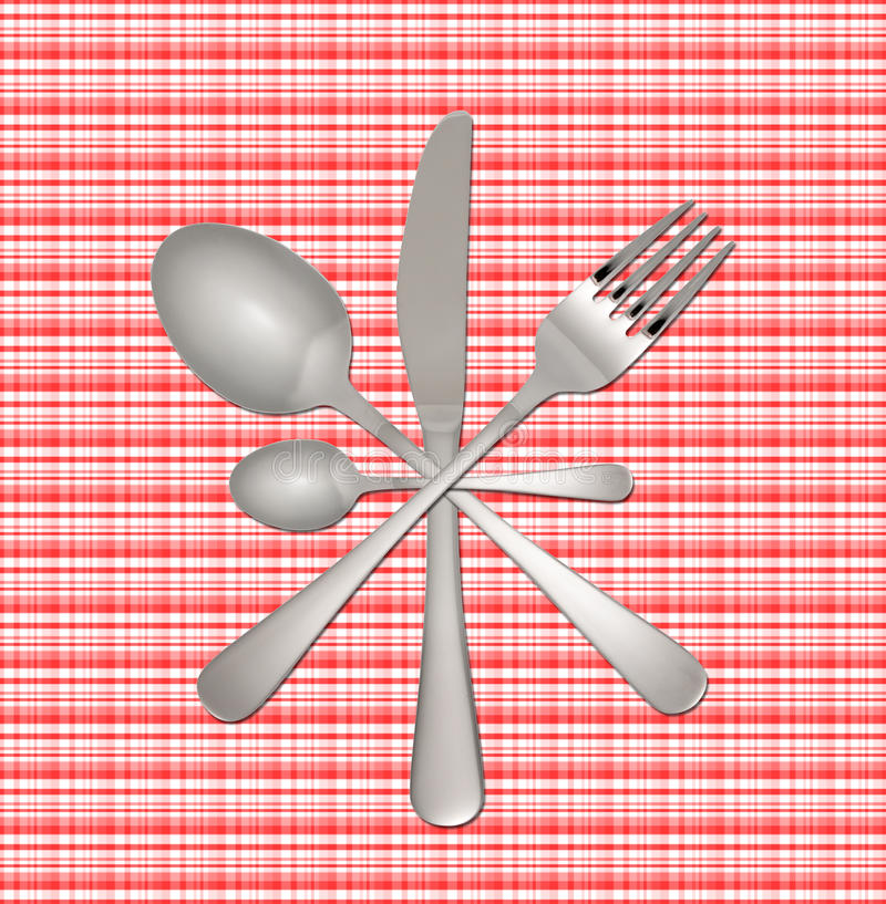 Fork, knife and spoon on checkered tablecloth
