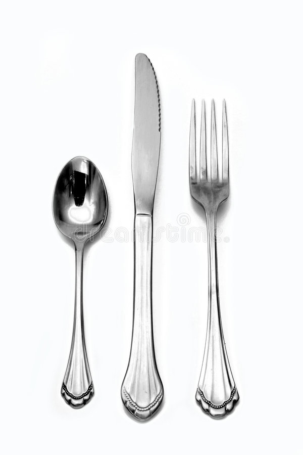 Fork knife spoon silverware. A knife, and a fork and a spoon in a silverware set royalty free stock photo