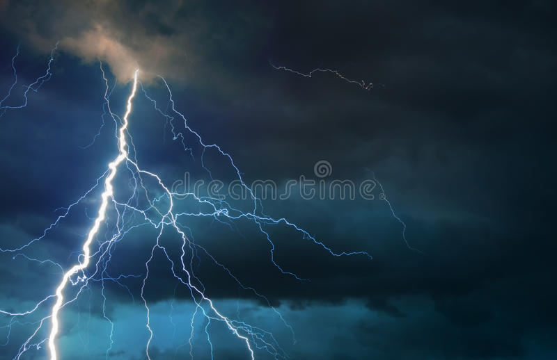Fork lightning striking during summer storm. Fork lightning striking down during summer storm royalty free stock images