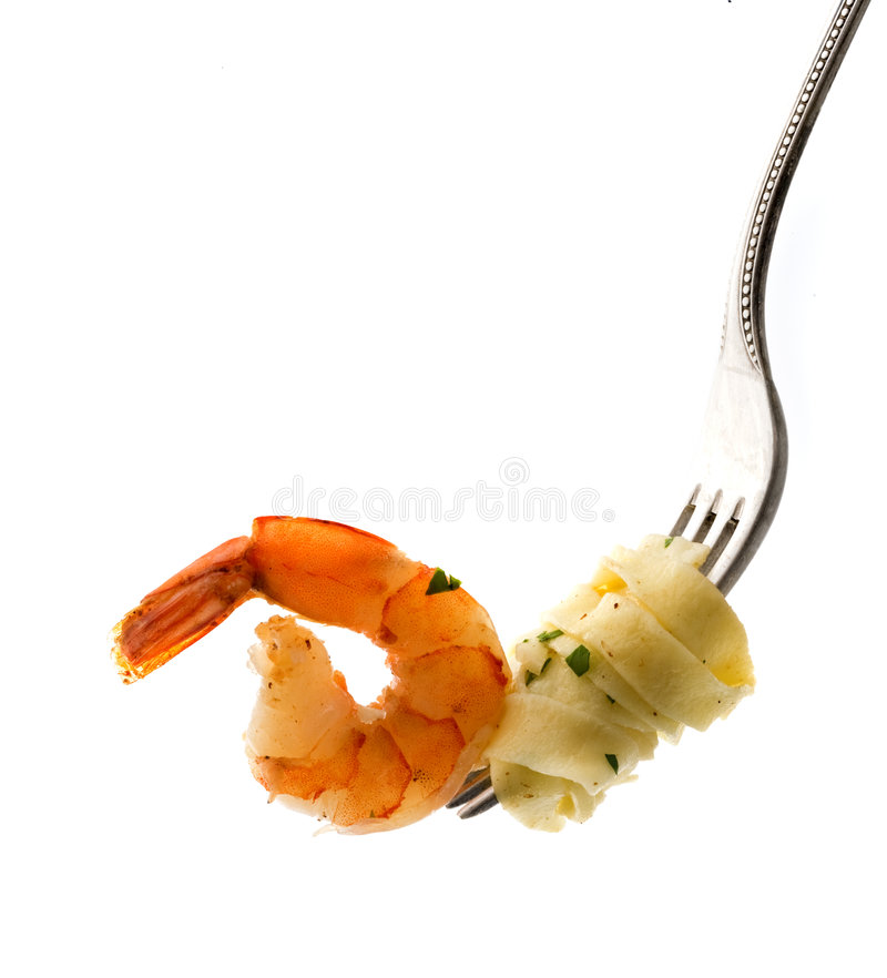 Fork with pasta and shrimp royalty free stock photo