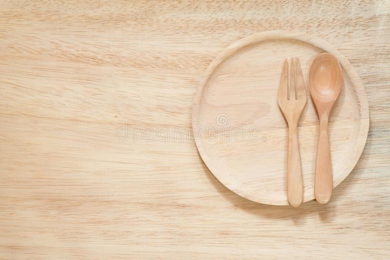 Fork and Spoon with dish on wood backgroundf royalty free stock image