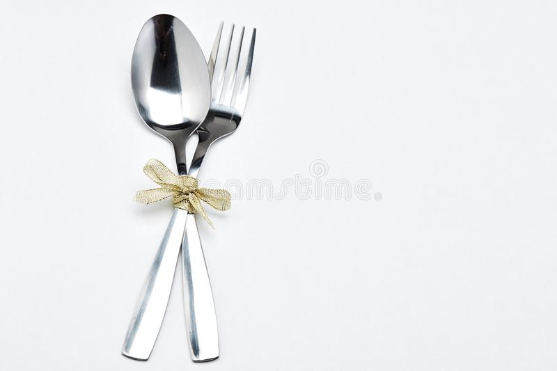 Fork and spoon with ribbon royalty free stock photos