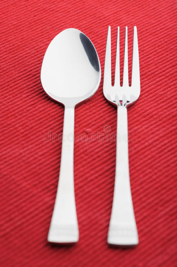 Fork spoon and knife. Isolated on red background royalty free stock images