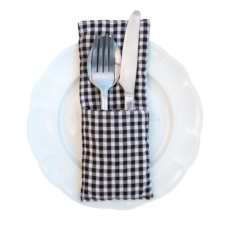Fork, spoon and knife set on white ceramic plate isolated on white background, clipping path included stock photo