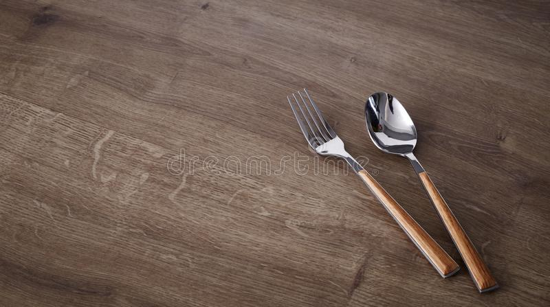 Fork and spoon on the old wood table stock photo