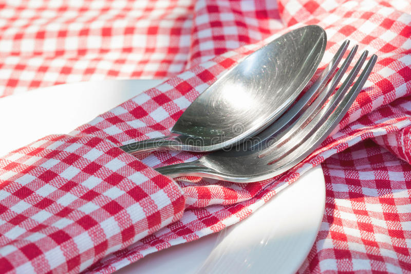 Fork and spoon on the red napkin. Close up stock photography
