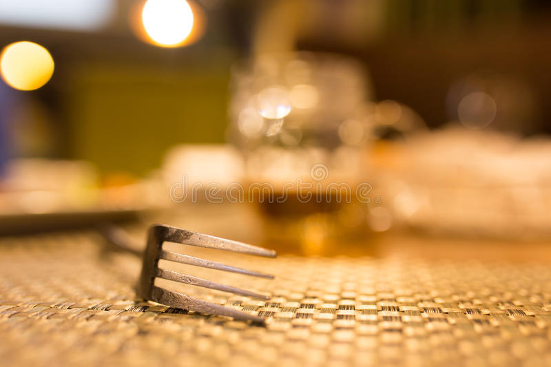 Fork on the table in the restaurant stock image