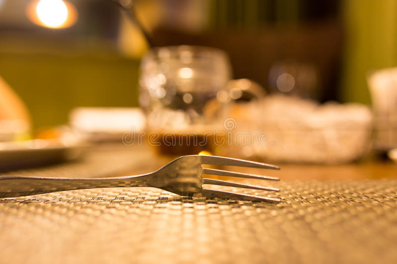 Fork on the table in the restaurant stock images