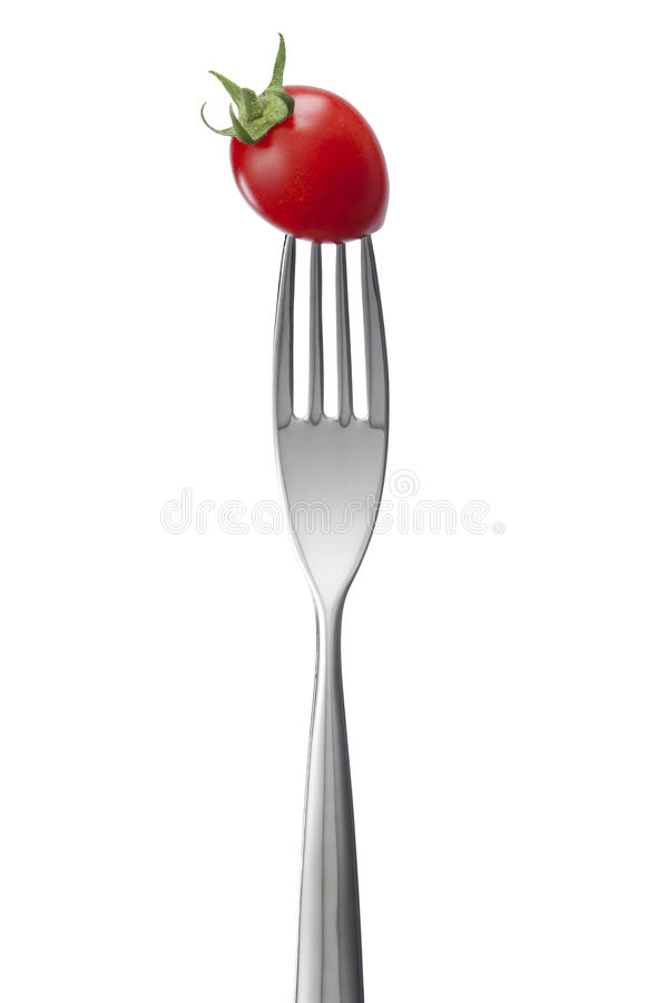 A Fork With Tomato Royalty Free Stock Photos