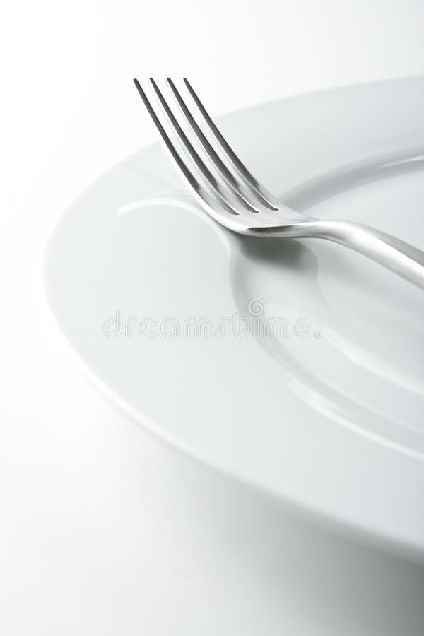 Fork on White Plate royalty free stock photography