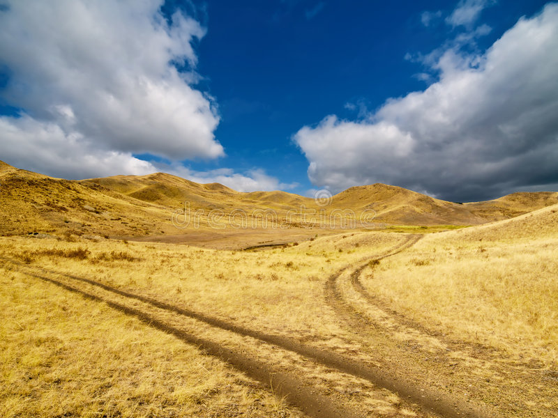 Forked road on a hillside stock image