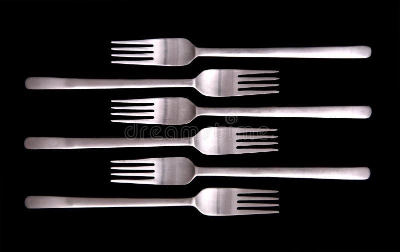 Forkes en fondo negro imágenes de archivo libres de regalías