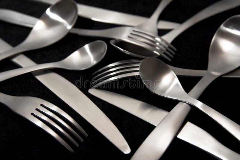 Forkes y cucharas de los cuchillos imagen de archivo libre de regalías