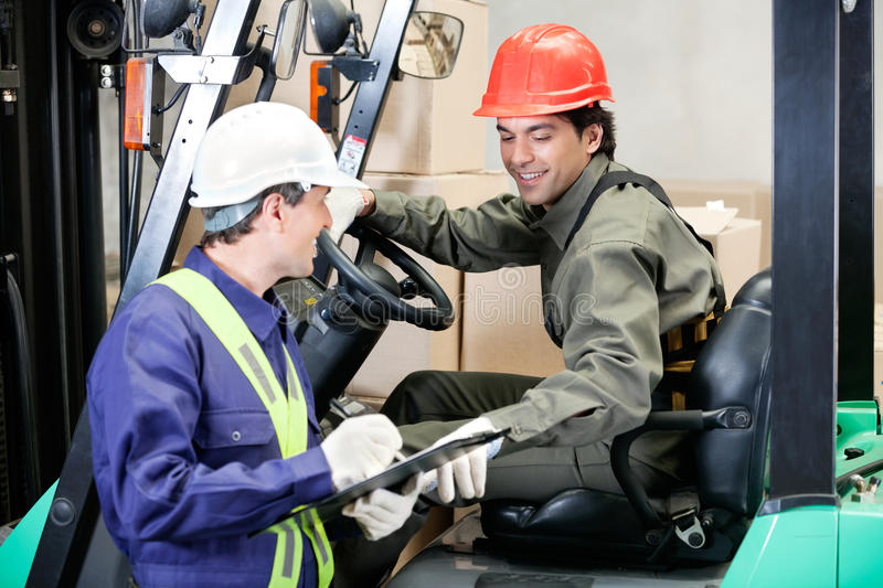 Forklift Driver Communicating With Supervisor stock photos