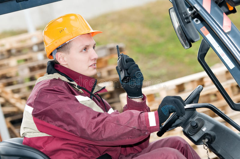 Forklift Driver With Radio Royalty Free Stock Photo
