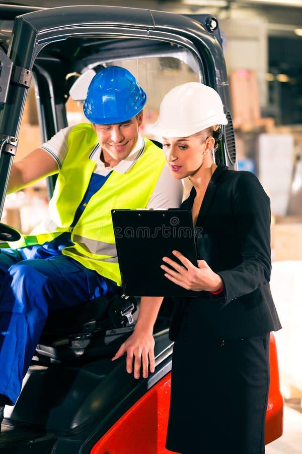 Download Forklift Driver And Supervisor At Warehouse Stock Image - Image: 28876413