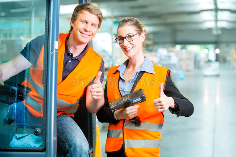 Forklift driver and supervisor at warehouse royalty free stock images