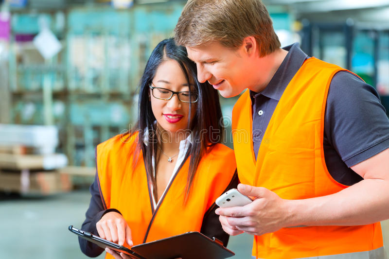 Forklift Driver And Supervisor At Warehouse Stock Photos