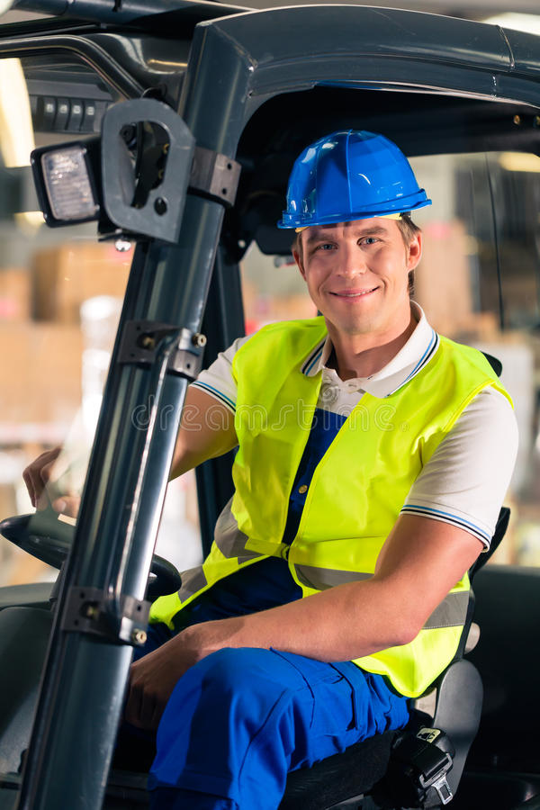Download Forklift Driver At Warehouse Of Forwarding Stock Photo - Image of express, machinery: 28876384
