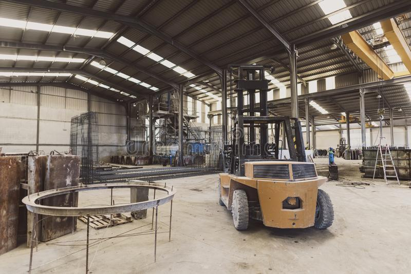Forklift in factory nobody workplace in wide angle image royalty free stock photo