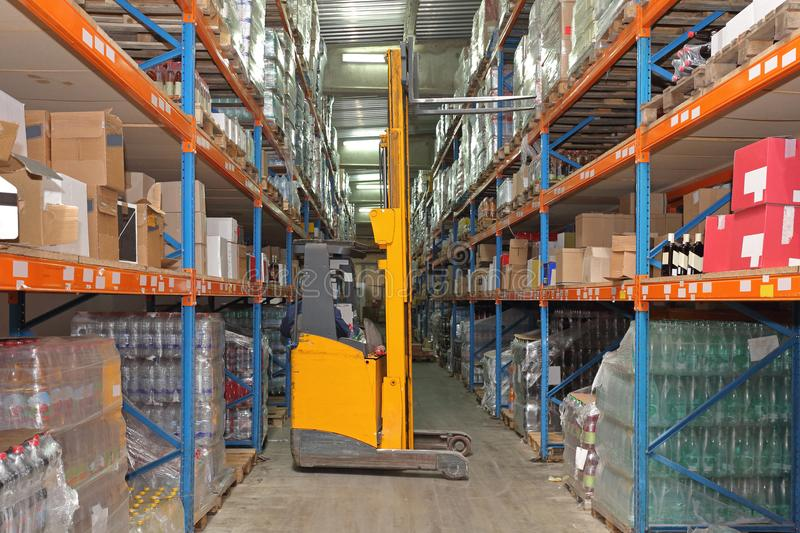 Forklift. Between Aisle in Distribution Warehouse royalty free stock photos