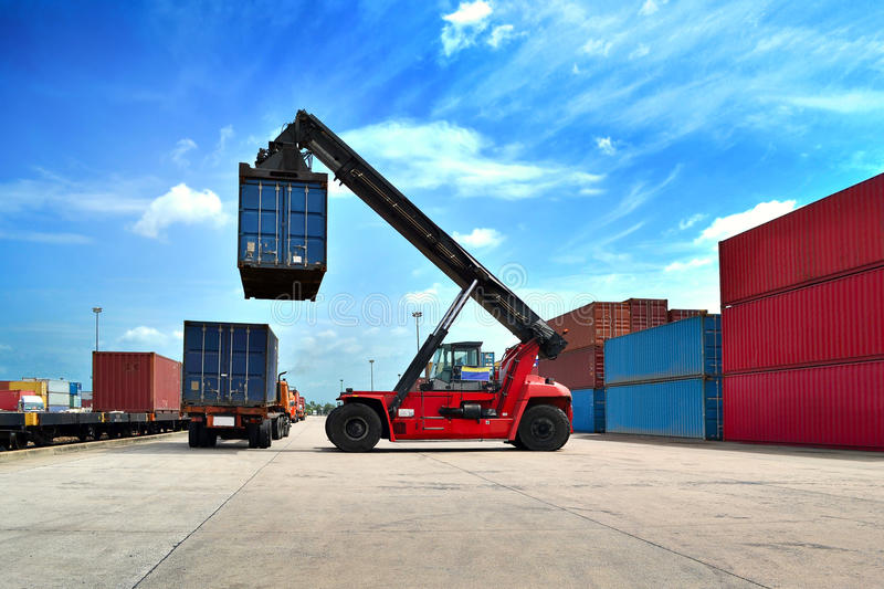 Forklift handling the container royalty free stock photo