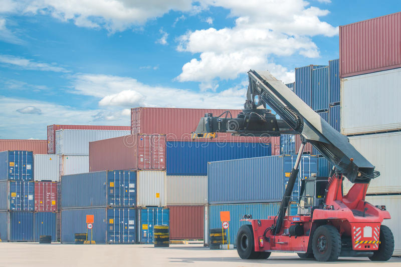 Forklift handling container box loading to truck in import expor. T logistic zone royalty free stock images