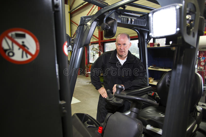 Forklift mechanic royalty free stock photo