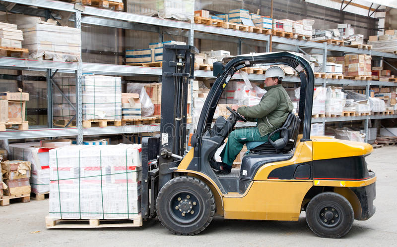 Forklift in motion at warehouse stock photo