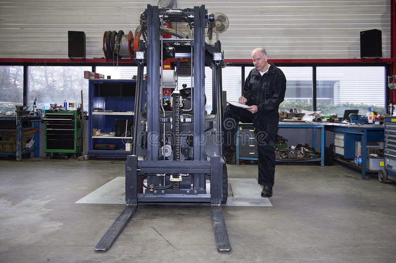 Forklift Quality Control royalty free stock image
