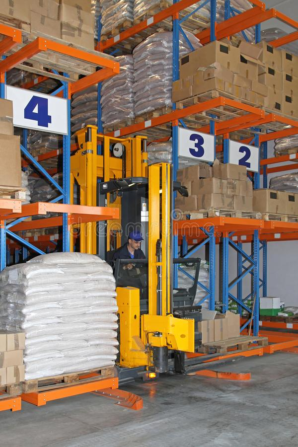 Forklift Stacker. Between Aisles in Distribution Center Warehouse stock photography
