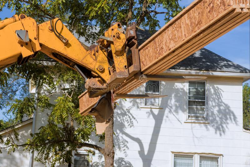 Forklift stacker loader construction showing joists trusses. Wooden frame house foundation, industry, loading, home, work, new, truck, freight, storage, beam stock images
