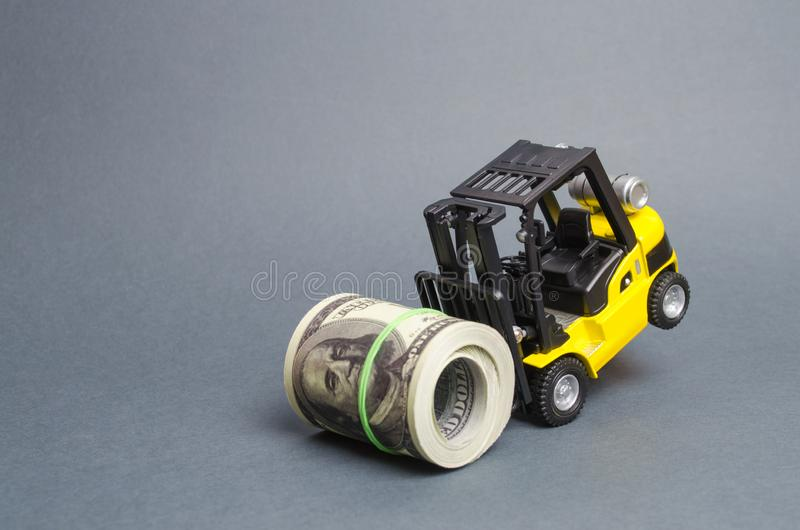 Forklift truck can not raise a bundle of dollars. Expensive loans, high tax burden. Generous financing, attracting investment. The development of allocated royalty free stock photography