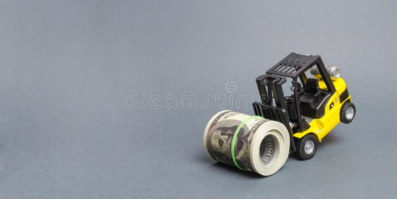 Forklift truck can not raise a bundle of dollars. Expensive loans, high tax burden. Generous financing, attracting investment. The development of allocated royalty free stock photos