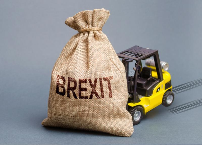 The forklift truck cannot budge the bag Brexit. UK withdrawal from the EU without deal agreement. A difficult political situation stock photo